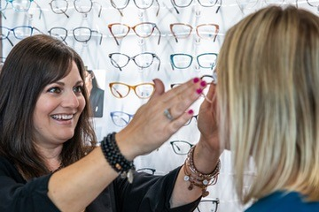 Female patient trying on women's prescription eye wear in San Diego